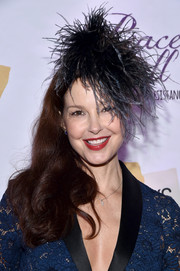 Ashley Judd sported a glamorous side sweep, complete with a feather headdress, at the Busboys and Poets' Peace Ball.