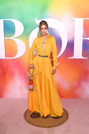 Gigi Hadid was cool and glam in a yellow maxi shirtdress by Brandon Maxwell at the #BoF500 2018.