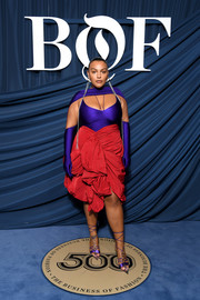 Paloma Elsesser looked vibrant in a Mugler dress with a fitted purple bodice and a puffy red skirt at the #BoF500 gala.