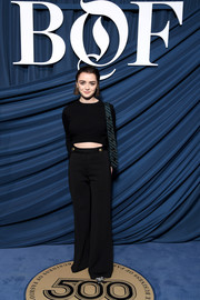 Maisie Williams attended the 2019 #BoF500 Gala wearing a simple black cutout sweater.