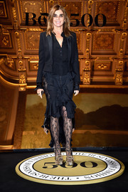Carine Roitfeld contrasted her masculine top with an ultra-girly ruffle skirt.