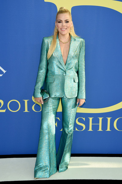 Busy Philipps Clamshell Clutch [blue,suit,fashion model,fashion,flooring,electric blue,formal wear,outerwear,carpet,fashion show,arrivals,busy philipps,brooklyn museum,new york city,cfda fashion awards]