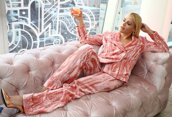 Busy Philipps Evening Pumps [furniture,sitting,room,flesh,leg,human,peach,textile,interior design,linens,three olives ros\u00e9 vodka,busy philipps,the standard east village,nyc,event,olives rose vodka launch]
