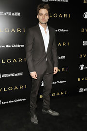 Sebastian Stan looked dapper in a pair of distressed gray loafers.