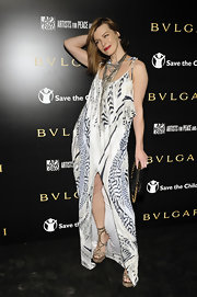 Milla is bohemian-chic in this floor length evening dress with a bold tribal print.