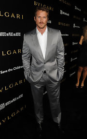 Jason looks striking in a silver gray suit.