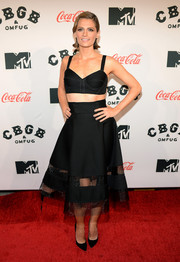Stana Katic went for a fun and sexy retro look with a black Donna Karan crop-top and a matching flared skirt during the premiere of 'CBGB' in New York.