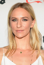 Mickey Sumner opted for a casual center-parted 'do with subtle waves when she attended the premiere of 'CBGB' in New York.