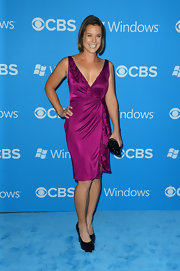 Ashley Williams looked great wearing a purple satin wrap-dress with a ruffle trim.