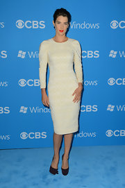 Cobie Smulders contrasted her fresh ivory lace frock with classic black platform pumps.