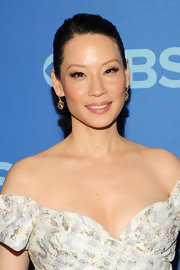 Lucy Liu made sure her face was front and center by pulling back her hair into this lovely updo.
