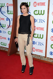 Jessica Stroup opted for casual attire at the TCA a party in a pair of modern black suede peep-toe booties. Slouchy khakis and a black lace shell finished off her look.