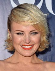 Malin Akerman looked dynamite with her bright orange lipstick.
