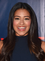 Gina Rodriguez styled her long hair with a center part and wavy ends for the CBS Summer TCA Party.
