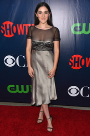Isabelle Fuhrman looked like a sultry prom girl at the CBS Summer TCA Party in a gray cocktail dress with a lace-accented bodice and a sheer yoke.