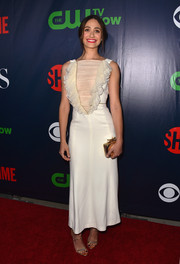 Emmy Rossum completed her gold-themed accessories with a Jimmy Choo box clutch.