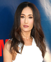 Maggie Q wore her long hair with a center part and a teased crown for a retro-chic vibe at the TCA Summer Press Tour.