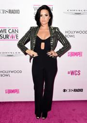 Demi Lovato added sparkle to her look with a sequin-striped jacket.