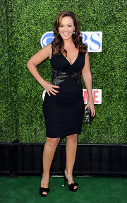 Leah showed off her bangin' bod in a black dress with detailing on the waist.