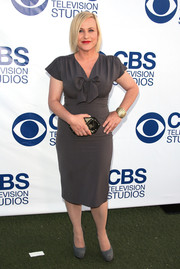 Patricia Arquette wore a dark gray cocktail dress with bow detail to the CBS Summer Soiree.
