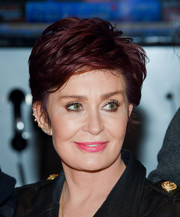 Sharon Osbourne showed off a stylish layered razor cut while visiting the New York Stock Exchange.