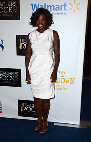 Viola Davis added a shimmering touch of gold to her crisp white cocktail dress.