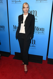 Jaime Pressly suited up in black with an undone bow tie for the 'Mom' 100 episodes celebration.