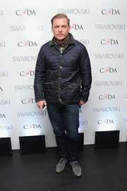 Shane Baum kept his look casual but stylish with this blue puffer jacket with quilting.