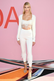 Devon Windsor completed her ensemble with strappy nude heels.