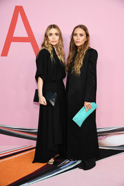 Ashley Olsen matched her frock with a black leather clutch.