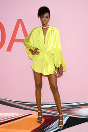 Maria Borges flaunted her long legs in a yellow mini dress by Azeeza at the 2019 CFDA Fashion Awards.
