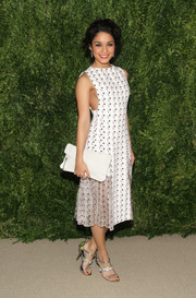 Vanessa Hudgens teamed her print dress with a simple white leather clutch.