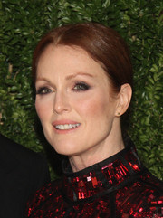 Julianne Moore slicked her hair back in a simple center-parted ponytail for the Fashion Fund finalists celebration.