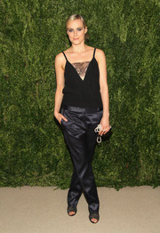 Taylor Schilling opted for a pair of navy silk pants, also by Thakoon, to complete her outfit.