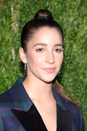 Aly Raisman wore her hair in a high ponytail at the CFDA/Vogue Fashion Fund 15th anniversary event.