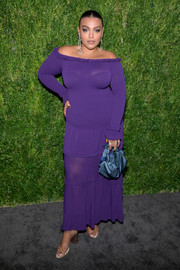 Paloma Elsesser showed off her curves in this purple off-the-shoulder maxi dress by Altuzarra at the CFDA/Vogue Fashion Fund 15th anniversary event.
