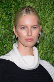 Karolina Kurkova opted for a casual center-parted bun when she attended the CFDA/Vogue Fashion Fund 15th anniversary event.