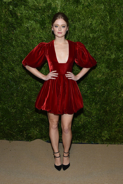 Anna Baryshnikov went for flirty glamour in a red velvet cocktail dress with a plunging neckline and a bubble skirt at the 2019 CFDA/Vogue Fashion Fund Awards.