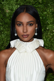 Jasmine Tookes opted for a straight, center-parted hairstyle when she attended the 2019 CFDA/Vogue Fashion Fund Awards.
