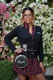 Laverne Cox accessorized with an adorable Kate Spade 'Caviar' bag at the CFDA/Vogue Fashion Fund show and tea.