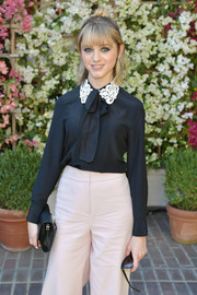 Natalia Dyer went for old-school sweetness in a black Kate Spade pussybow blouse with a contrast lace collar at the CFDA/Vogue Fashion Fund show and tea.