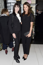 Helena Christensen donned a black jumpsuit with sparkly sleeves for the 'Hair by Sam McKnight' celebration.