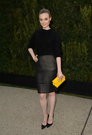 Bella's dark gray checked pencil skirt topped off her super sleek look.