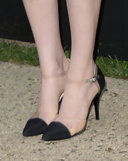 Bella Heathcote chose a pair of black satin and clear plastic sandals for her super sophisticated look at the Chanel Dinner in LA.