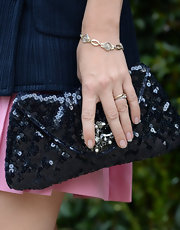 Emily Mortimer chose a midnight blue sequined clutch to top off her look at the Chanel Dinner of NRDC.