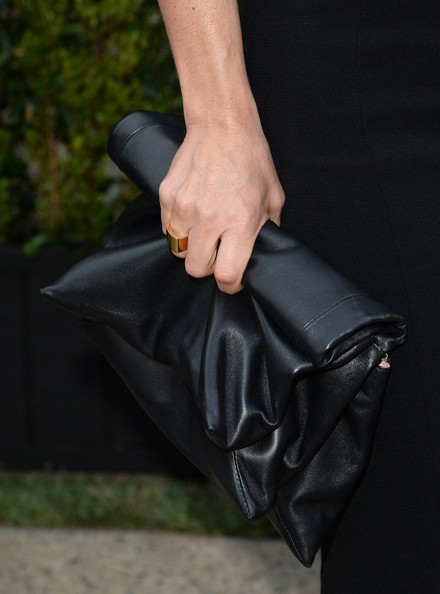 Rosetta Millington accessorized her black dress with this oversized leather clutch.