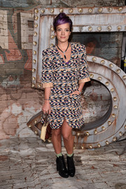 Lily Allen accessorized simply with a pair of platform Chelsea boots at a Chanel dinner.