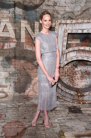 Lauren Santo Domingo kept the shimmer coming with a pair of silver ankle-strap sandals.