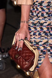 Lily Allen remained quirky with a brown quilted Chanel bag from the infamous supermarket collection at a Chanel dinner.