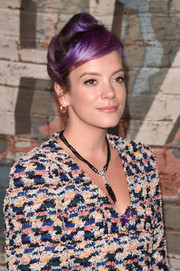 Lily Allen wrapped her purple hair in a retro updo for a Chanel dinner.
